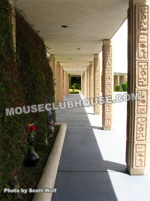This pathway which leads to the front door features beautifully aligned stonework columns. From this angle, it seemed like a perfect residence for the man who was the art director of Donald in Mathmagic Land. Just look at all the geometric shapes that can be recognized from this one angle! At the left, on the other side of the greenery is a tennis court nestled into the surrounding mountain scenery.