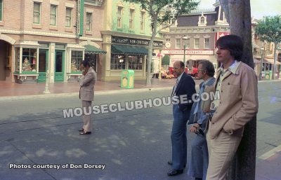 Bob Jani stands on Main Street in Disneyland to hear the America on Parade soundtrack mix (1975)