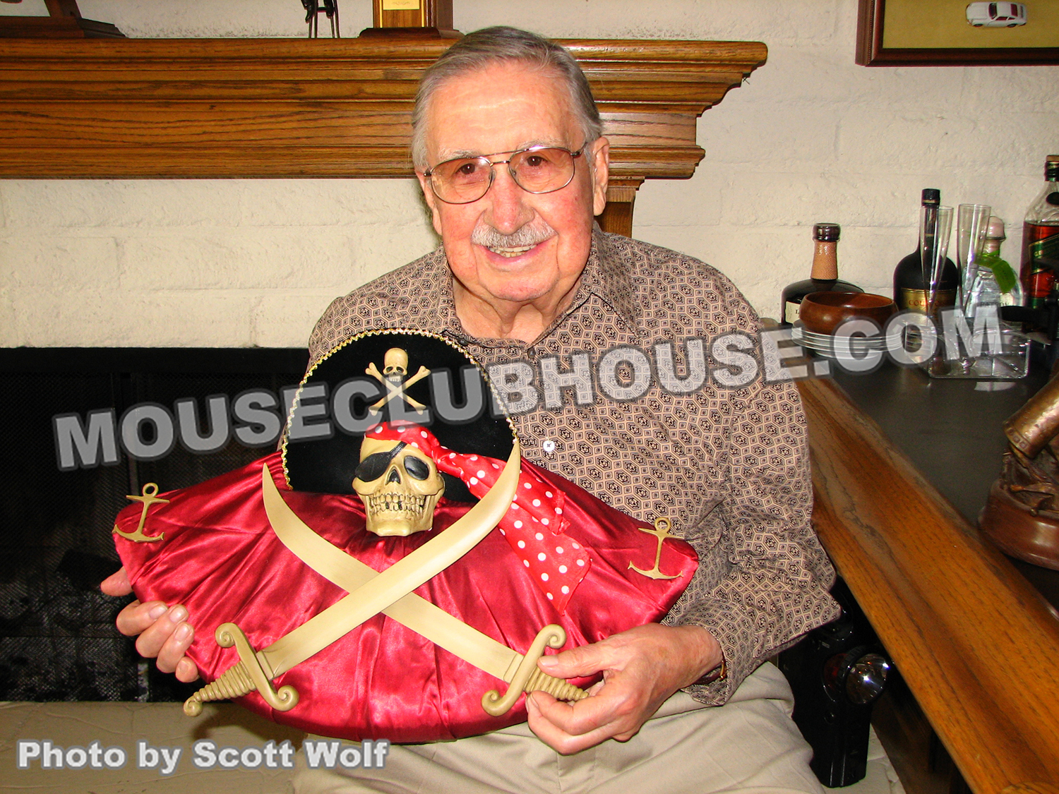 X Atencio with a replica of the Jolly Roger that he provides the voice for and wrote the dialogue for