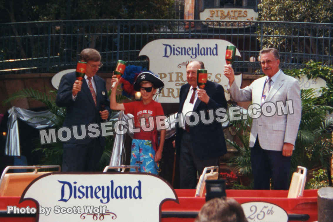 Disneyland vice president Norm Doerges, a boy from the audience, Pirates designers Marc Davis and X Atencio for the 25th anniversary of the Pirates of the Caribbean attraction in 1992