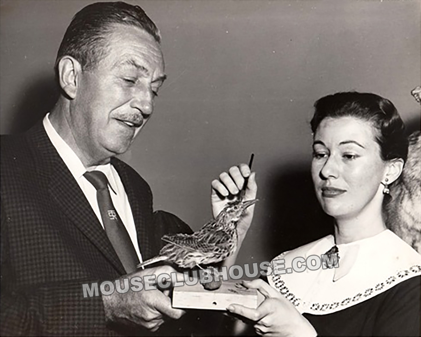Walt Disney and Harriet Burns study a bird