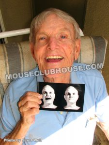 "Jay Meyer with a photo of his image in the ""Haunted Mansion"""