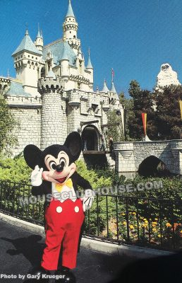 Mickey Mouse in front of Sleeping Beauty Castle in Disneyland, postcard photo by Gary Krueger