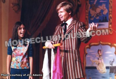 "Jim Adams delights an audience member during the ""Golden Horseshoe Revue"""