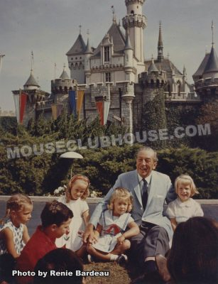 Walt surrounded by children